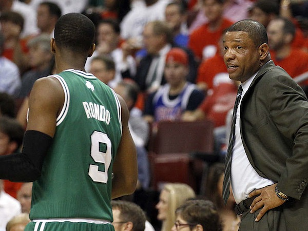 Boston Celtics head coach Doc Rivers talks to point guard Rajon Rondo.  (Yong Kim/Staff Photographer)