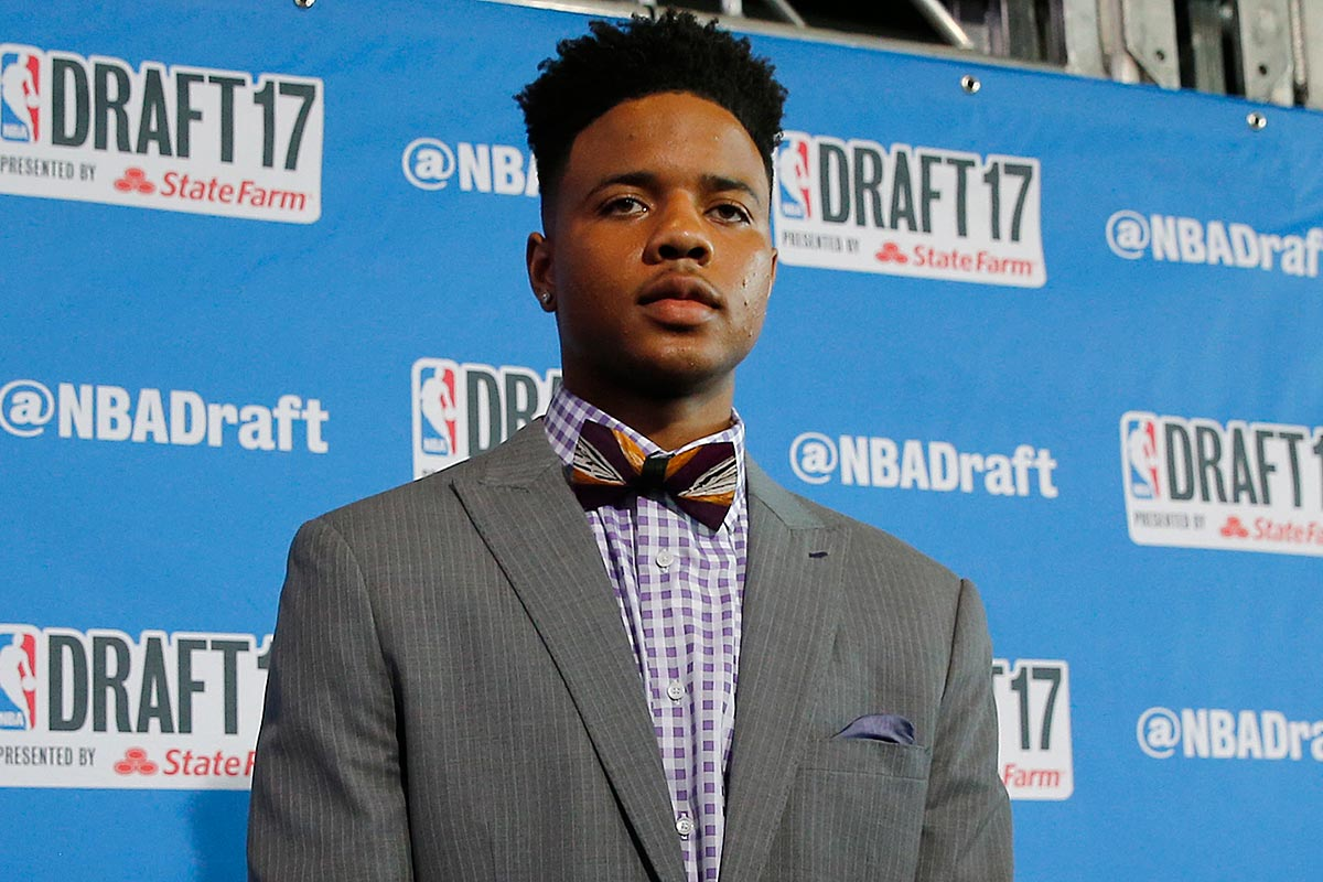 Markelle Fultz stops for photographers while walking the red carpet before the start of the 2017 NBA Draft at the Barclays Center in Brooklyn, New York.