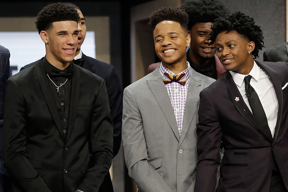 Markelle Fultz (center) with De´Aaron Fox (right) and Lonzo Ball during a group photo session before the start of the 2017 NBA Draft.