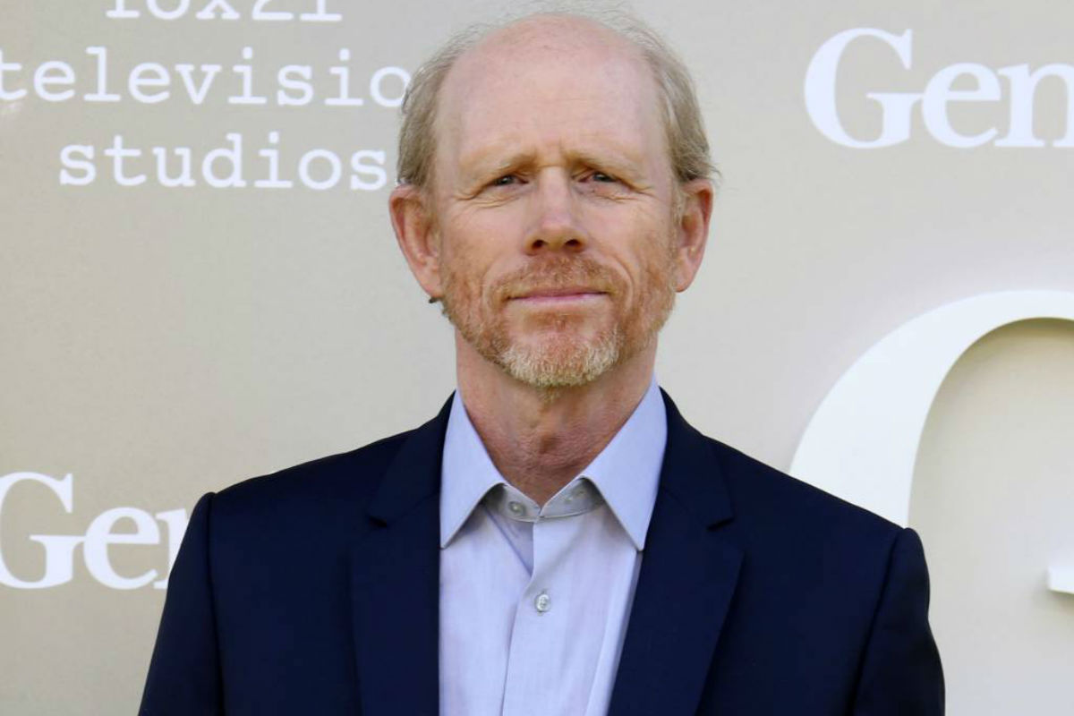"FILE - In this April 24, 2017 file photo, filmmaker Ron Howard arrives at the premiere of ""Genius"", in Los Angeles. Howard is taking command of the Han Solo ""Star Wars� spinoff after the surprise departure of directors Phil Lord and Christopher Miller. Lucasfilm announced their replacement director Thursday, June 22, two days after Lord and Miller left the project over creative differences."