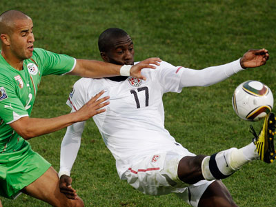 Jozy Altidore, right, controls the ball past Madjid Bougherra during the World Cup group C match between the U.S. and Algeria. (AP Photo / Michael Sohn)