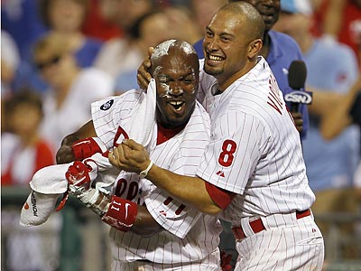 Shane Victorino greets Jimmy Rollins with shaving cream after Rollins hit a walk-off home run. (Yong Kim / Staff Photographer)