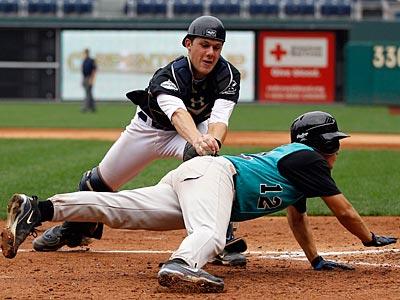 Burlington County catcher Joey Frey tags out Lehigh Valley&acute;s Davin<br />Pagan during championship game. (AP Photo/Matt Rourke)