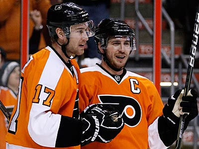 Former Flyers Jeff Carter and Mike Richards will be reunited again in Los Angeles. (Matt Slocum/AP Photo)