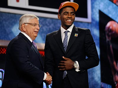 First overall draft pick Kyrie Irving, who was selected by the Cleveland Cavaliers, poses with NBA Commissioner David Stern. (Bill Kostroun/AP)