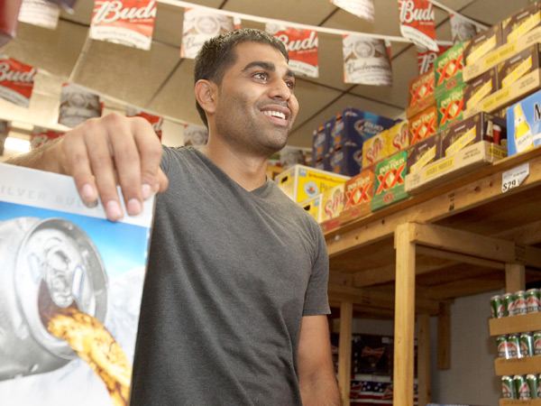 Patel fielded call after call Sunday from local news outlets: His shop on the corner of 15th and Federal Streets had sold the winning Powerball ticket, worth $131.5 million. (Charles Fox / Staff)