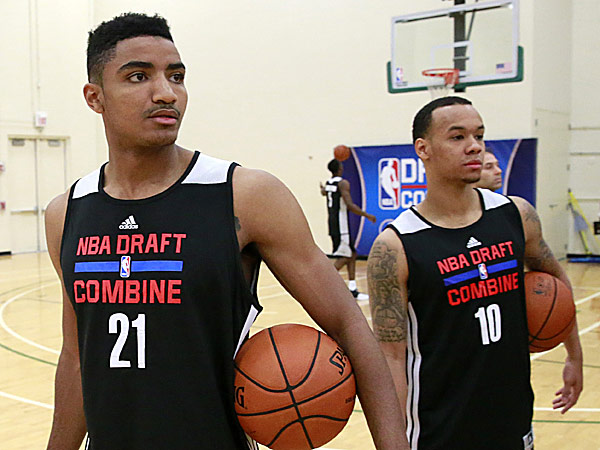Guards Gary Harris, from Michigan State, and Shabazz Napier, from Connecticut. (Charles Rex Arbogast/AP)