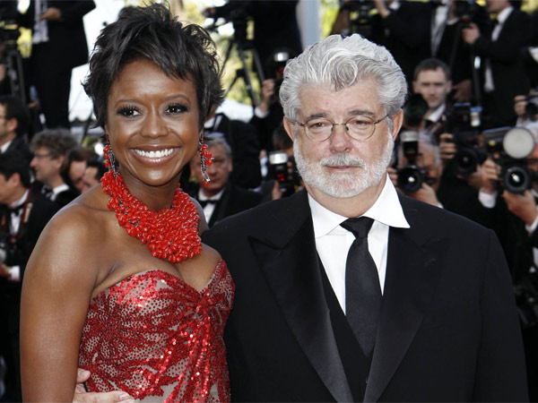 """Filmmaker George Lucas with longtime girlfriend Mellody Hobson at a screening of """"Wall Street Money Never Sleeps."""" A Lucasfilm spokeswoman confirms the """"Star Wars"""" creator married Hobson in a weekend ceremony at Skywalker Ranch north of San Francisco."""