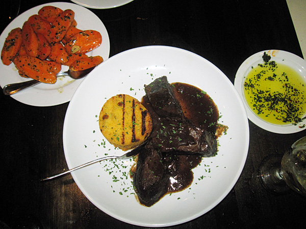 This May 28, 2014 photo shows braised short ribs, served with a crispy cake of polenta, and a side dish of carrots slice in long ovals, cooked in Marsala, at Antica, a restaurant in Chadds Ford, Pa. The restaurant is located near the Brandywine River Museum, which has an extensive collection of artwork by the Wyeth family and offers tours of nearby homes and studios where N.C. Wyeth, his son Andrew Wyeth and grandson Jamie Wyeth lived and worked. The restaurant is decorated with prints of Wyeth artwork. (AP Photo/Beth J. Harpaz)