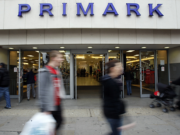 People walk past a Primark shop in London, Wednesday, April 14, 2010. (AP Photo/Kirsty Wigglesworth)