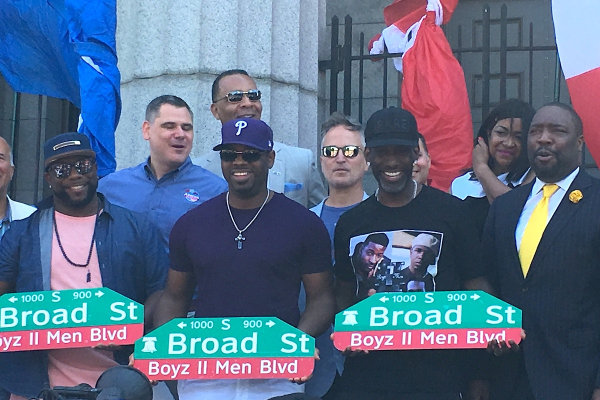 Members of Boyz II Men (from left) Wanya Morris, Nate Morris and Shawn Stockton joined city officials Saturday to unveil a replica of street sign renaming Broad Street between Christian and Carpenter Streets in their honor.