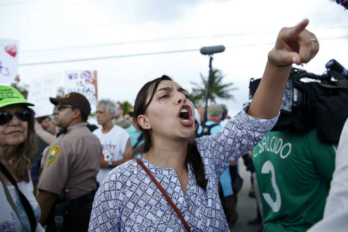 A protester yells toward a Trump supporter after arriving to the Homestead Temporary Shelter for Unaccompanied Children, on Saturday, June 23, 2018, in Homestead, Fla.