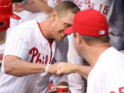 Hunter Pence pounds fist with Jim Thome after scoring a run in the first inning. (Steven M. Falk/Staff Photographer)