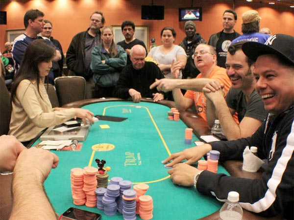 Players enjoy the game at the March Deaf Poker Tour at the Taj Mahal. Below, tournament founders (from left) Nathan Montoya, Jarrod Musano, James Rydstrom, Andy Foster, Alok Doshi and Joey Seifner. (CHAYA SELZERTATE TULLIER)