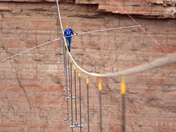 Nik Wallenda walks across a 2-inch wire 1,500 feet above the ground to cross the Grand Canyon. (Tiffany Brown/AP Images for Discovery Communications)