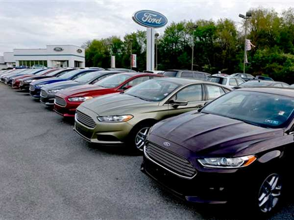 In this Wednesday, May 8, 2013 photo, new 2013 Ford Fusions are seen at an automobile dealer in Zelienople, Pa. The Commerce Department reports on business orders for durable goods in May, on Tuesday, June 25, 2013. (AP Photo/Keith Srakocic)