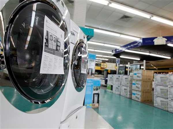 In this April 27, 2012 photo, washing machines and air conditioners line the aisles of a Cowboy Maloney´s Electric City Superstore in Jackson, Miss. (AP Photo/Rogelio V. Solis)