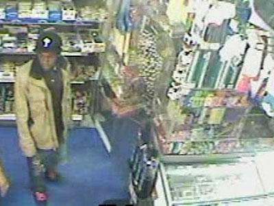 Police say this surveillance image shows Isiah Baldwin minutes before robbing a West Philly bodega on May 12. (File photo)