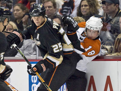 Former Anaheim Ducks defenseman Chris Pronger, left, checks Flyers center Mike Richards into the boards during a Jan. 2 game in Anaheim. The Flyers traded Joffrey Lupul, Luca Sbisa and two first-round draft choices Friday to obtain Pronger. (AP Photo/Mark Avery)