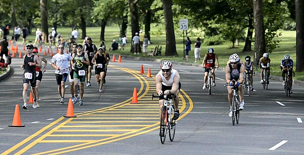 Participants in the 2011 Philadelphia Triathlon run and bike along Martin Luther King Boulevard. (Ron Tarver/Staff Photographer)