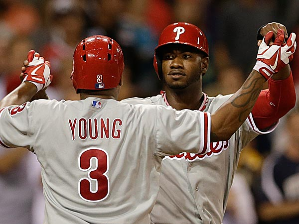 The Phillies´ Domonic Brown and teammate Delmon Young celebrate Young´s two-run home against the Padres in the eighth inning. (Gregory Bull/AP)