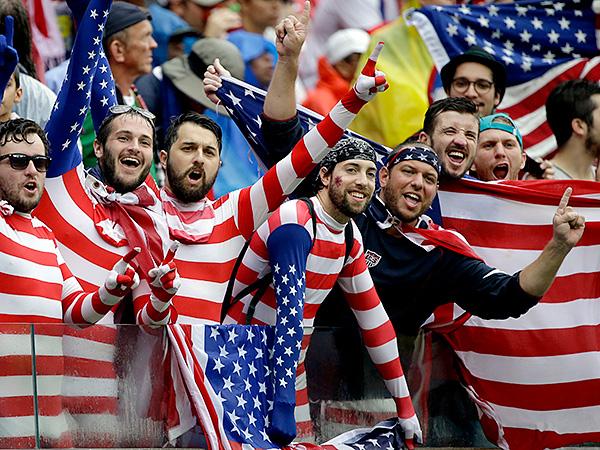 USA supporters cheer for their national team. (AP Photo/Ricardo Mazalan)