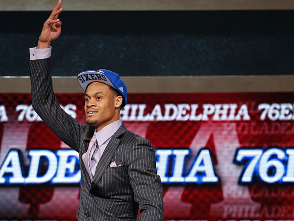 Clemson forward K.J. McDaniels motions to fans after being selected 32nd overall by the Philadelphia 76ers in the second round of the 2014 NBA draft, Thursday, June 26, 2014, in New York. (Jason DeCrow/AP)