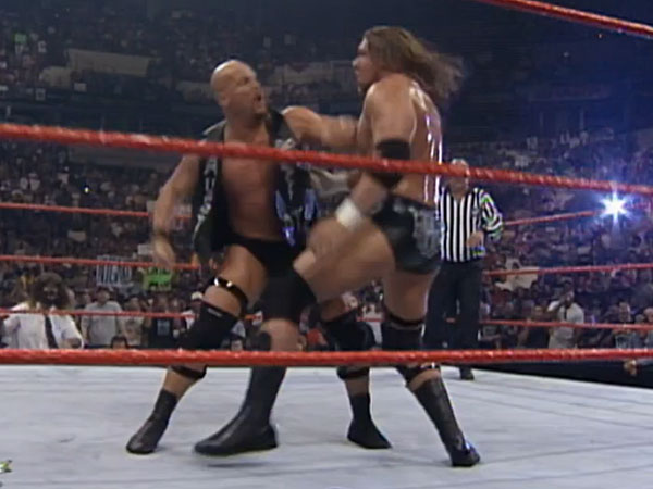 Steve Austin gears up to strike Triple H. (Photo courtesy of the WWE Network)