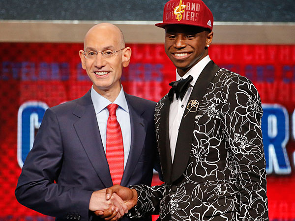 NBA Commissioner Adam Silver, left, congratulates Andrew Wiggins of Kansas who was selected by the Cleveland Cavaliers as the number one pick in the 2014 NBA draft, Thursday, June 26, 2014, in New York. (Jason DeCrow/AP)