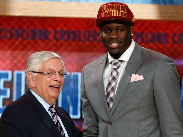 NBA Commissioner David Stern, left, shakes hands with UNLV´s Anthony Bennett, who was selected first overall by the Cleveland Cavaliers in the NBA basketball draft, Thursday, June 27, 2013, in New York. (Jason DeCrow/AP)