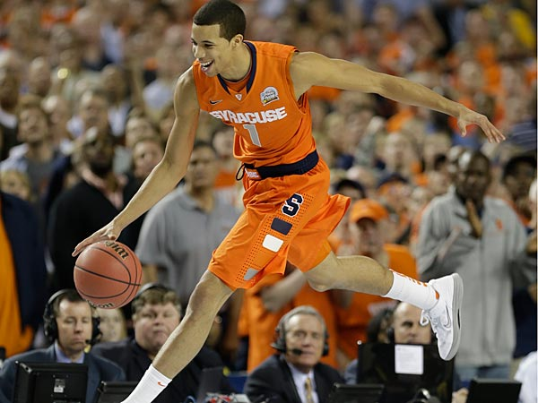 The Sixers selected Michael Carter-Williams with their 11th pick in the first-round of the NBA trade.(AP Photo/Charlie Neibergall)