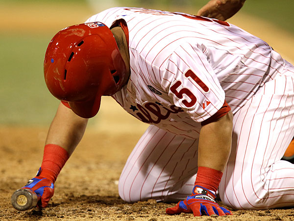 Carlos Ruiz reacts after being hit by a pitch in the 11th inning of a baseball game against the Florida Marlins, Thursday, June 26, 2014, in Philadelphia. the Phillies won 5-3. (Laurence Kesterson/AP)