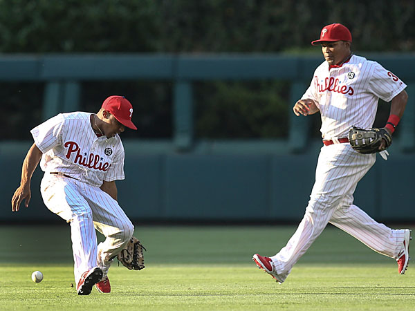 Ben Revere can´t get a glove on the Braves´ Justin Upton´s pop-up. (Steven M. Falk/Staff Photographer)