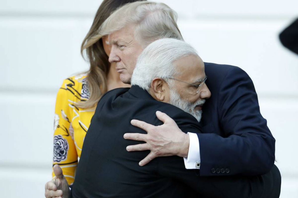FILE - In this June 26, 2017, file photo, Indian Prime Minister Narendra Modi hugs President Donald Trump as Modi departs the White House in Washington. U.S. President Donald Trump should have been ready for a bear hug from Narendra Modi this week in Washington. The folksy embrace has become a signature move for the Indian prime minister in greeting global leaders and celebrities alike.