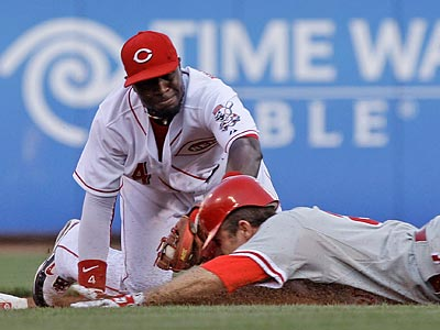 Charlie Manuel said after the Phillies´ 7-3 loss at Cincinnati that Chase Utley injured a hand during the game. (Al Behrman/AP)