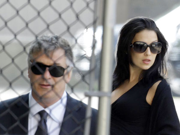 "Alec Baldwin, left, and his wife Hilaria Thomas arrive at Cathedral Church of Saint John the Divine before funeral services actor James Gandolfini, Thursday, June 27, 2013, in New York. Gandolfini, who played Tony Soprano in the HBO show ""The Sopranos"", died while vacationing in Italy last week. (AP Photo/Julio Cortez)"