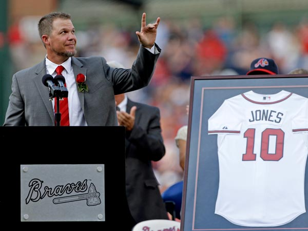 Former Atlanta Braves player Chipper Jones waves to the crowd as he steps to the podium during a pregame ceremony retiring his number before a baseball game between the Atlanta Braves and the Arizona Diamondbacks, Friday, June 28, 2013, in Atlanta. (David Goldman/AP)
