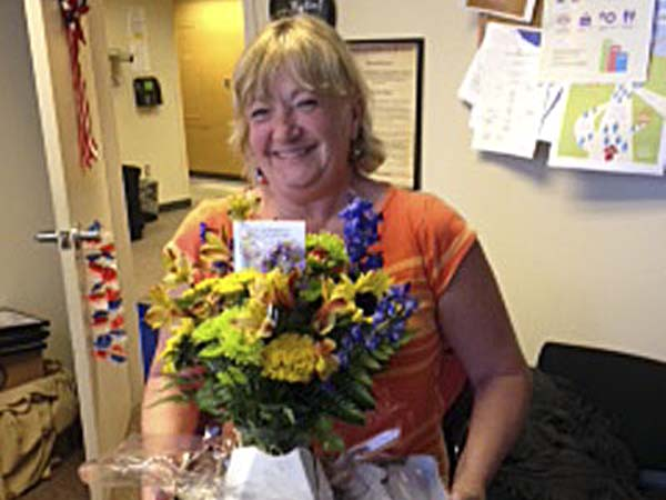 The cops wouldn&acute;t help Pam Krewson pursue a wallet-stealing perp, so she pursued him herself. Here she holds thank-you flowers from the wallet&acute;s grateful owner.<br /><br />