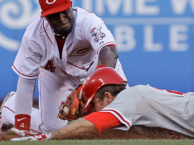 Chase Utley injured his hand on this slide into second base during the fourth inning of Monday´s game. (Al Behrman/AP)