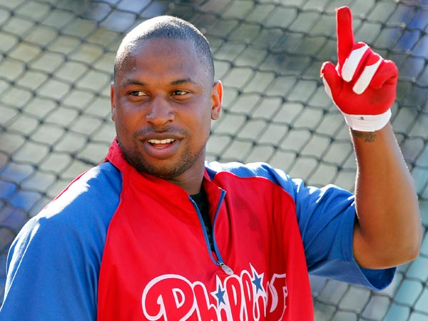 Delmon Young points to the sky during batting practice to warmup to play against the Los Angeles Dodgers in a baseball game Friday, June 28, 2013, in Los Angeles. (Alex Gallardo/AP)