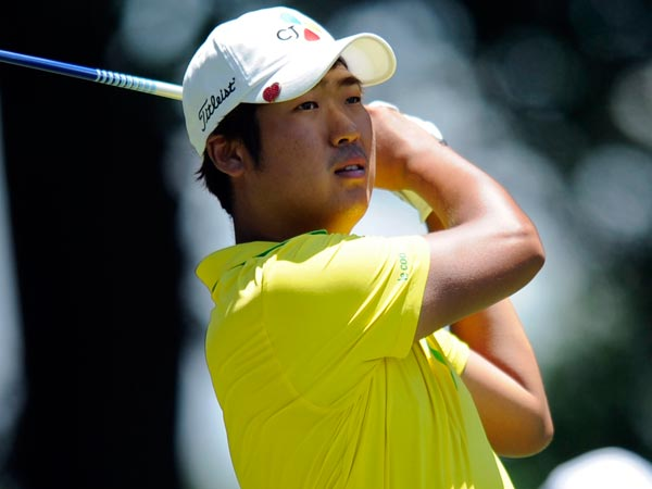 D.H. Lee, of South Korea, watches his drive from the fourth tee during the third round of the AT&T National golf tournament at Congressional Country Club, Saturday, June 29, 2013, in Bethesda, Md. (Nick Wass/AP)