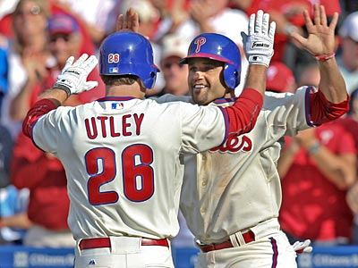 Both Chase Utley and Placido Polanco will seek second opinions on their injuries on Thursday. (Steven M. Falk / Staff Photographer)