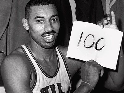 The iconic image of Wilt Chamberlain taken after he scored 100 points in Hershey, Pa. (Paul Vathis/AP file photo)