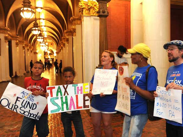 Protesters line the halls of the Capitol building Sunday, June 29, 2014, in Harrisburg, Pa. Pennsylvania state lawmakers were returning to the Capitol for an unusual weekend session Sunday as Republicans try to advance an approximately $29 billion spending plan for the new fiscal year that starts in less than 40 hours. (AP Photo/Bradley C Bower)