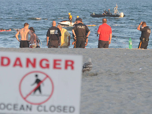 Emergency personnel searched for a 14-year-old boy who went missing in the waves off Ocean City, N.J., in June after he was swept out by a rip current. Authorities warn that rip currents will be a problem again today. (CURT HUDSON/Staff)