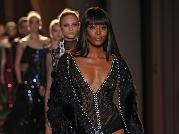 Naomi Campbell wears a creation by  fashion designer Donatella Versace during her Women´s Fall Winter 2013 haute couture fashion collection in Paris, France, Sunday, June 30, 2013. (AP Photo/Jacques Brinon)