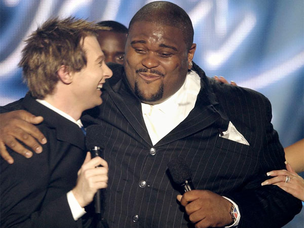 American Idol winner Ruben Studdard, of Birmingham, Ala., center, hugs finalist Clay Aiken, from Raleigh, N.C., after the finale of the show, Wednesday, May 21, 2003, in Universal City, Calif. (AP Photo/Kevork Djansezian)