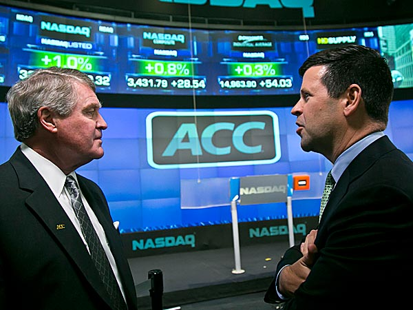 Atlantic Coast Conference commissioner John Swofford, left, and NASDAQ head of listings Bob McCooey chat before the ringing of the closing bell. (Bebeto Matthews/AP)