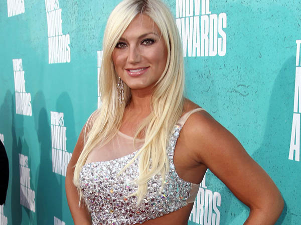 FILE - In this June 3, 2012 file photo, TV personality Brooke Hogan arrives at the MTV Movie Awards in Los Angeles. Hogan, the daughter of wrestler Hulk Hogan, is engaged to Dallas Cowboys offensive lineman Phil Costa. The former reality TV star and recording artist announced on Instagram that Costa proposed over the weekend in Las Vegas. Costa´s agent, George Mavrikes, confirmed the engagement Monday, July 1, 2013. (Photo by Matt Sayles/Invision/AP, File)
