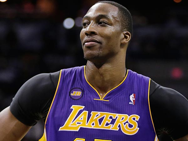 Lakers center Dwight Howard is hearing strong arguments from several teams during free agency. (AP Photo/Eric Gay)